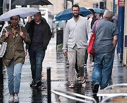 After the really hot weather, Edinburgh was hit by a thundestorm this evening<br /> <br /> Pictured: People in Lothian Road hurry to escape the rain<br /> <br /> Alex Todd | Edinburgh Elite media