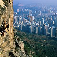 Olivia Hsu climbs on Lion Rock high above Hong Kong