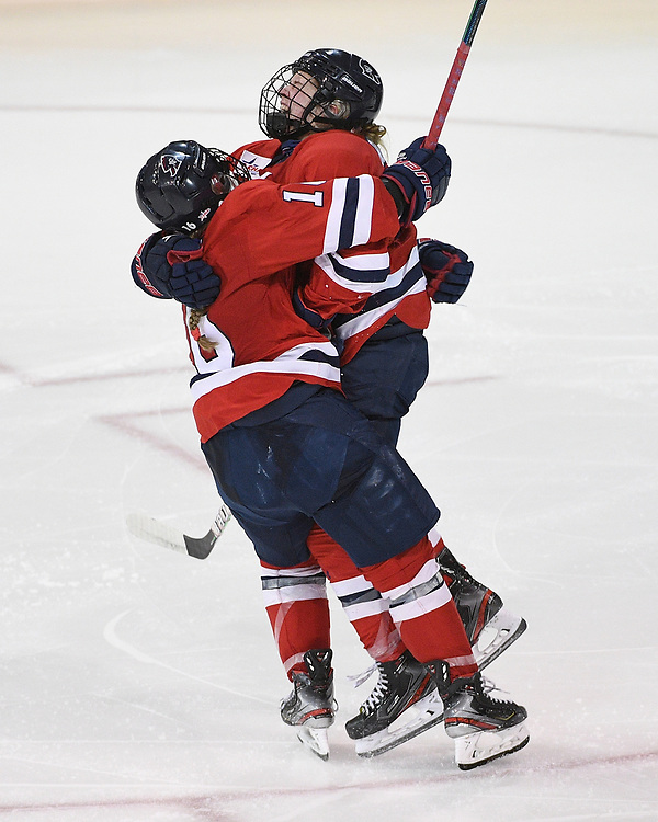ERIE, PA - MARCH 05: Maggy Burbidge #9 of the Robert Morris Colonials celebrates with Michaela Boyle #16 after scoring the game winning goal in overtime to give the Colonials a 3-2 win over the Mercyhurst Lakers at the Erie Insurance Arena on March 5, 2021 in Erie, Pennsylvania. (Photo by Justin Berl/Robert Morris Athletics)