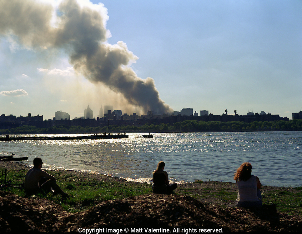 The cloud of smoke and dust rising from the World Trade Center, as seen from Brooklyn, looking across the East River