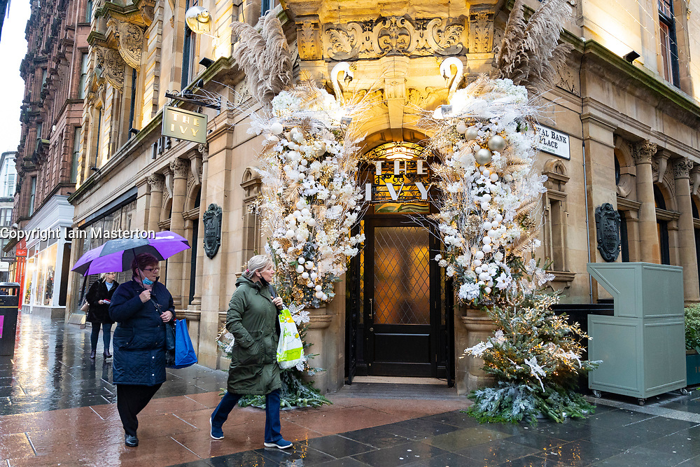Glasgow, Scotland, UK. 11 December 2020. Covid-19 lockdown level 4 restrictions are lifted in Glasgow. Non essential businesses and restaurants can reopen from today. Pictured ; The Ivy restaurant on Argyle Street with Christmas decorations can reopen from tonight.   Iain Masterton/Alamy Live News