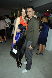 ROKSANDA ILINCIC and ROLAND MOURET at a reception hosted by Vogue magazine to launch photographer Tim Walker's book 'Pictures' sponsored by Nude, held at The Design Museum, Shad Thames, London SE1 on 8th May 2008.<br /><br />NON EXCLUSIVE - WORLD RIGHTS