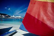 12 FEBRUARY 1986, OCHO RIOS, JAMAICA: Catamarans rental sailboats on the beach with a cruise ship and resort hotels in the background in Ocho Rios, Jamaica, Feb. 1986..PHOTO BY JACK KURTZ