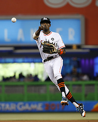 June 21, 2017 - Miami, FL, USA - Miami Marlins second baseman Dee Gordon throws to first to put out Washington Nationals center fielder Brian Goodwin during the fourth inning on Wednesday, June 21, 2017 at Marlins Park in Miami, Fla. (Credit Image: © David Santiago/TNS via ZUMA Wire)