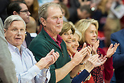 DALLAS, TX - DECEMBER 16: Former U.S. President George W. Bush and his wife Laura Bush cheer after the National Anthem before tipoff between the SMU Mustangs and the Nicholls State Colonels on December 16, 2015 at Moody Coliseum in Dallas, Texas.  (Photo by Cooper Neill/Getty Images) *** Local Caption *** George W. Bush; Laura Bush