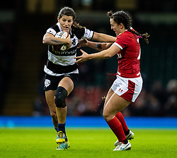 Rebecca Clough of Barbarians under pressure from Robyn Wilkins of Wales<br /> <br /> Photographer Simon King/Replay Images<br /> <br /> Friendly - Wales v Barbarians - Saturday 30th November 2019 - Principality Stadium - Cardiff<br /> <br /> World Copyright © Replay Images . All rights reserved. info@replayimages.co.uk - http://replayimages.co.uk