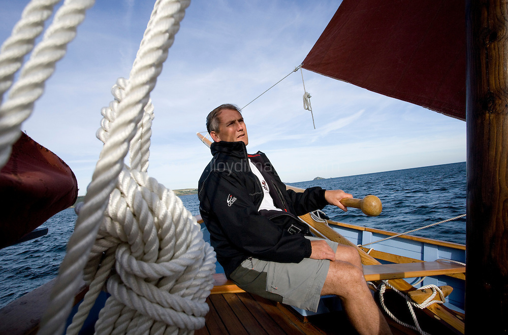 """The Spirit of Mystery sailing. Plymouth Sound and Rame Head. Cornwall. UK..Pictures shows Pete Goss onboard  his new Cornish Lugger """"Spirit of Mystery"""". Pete and a crew made up from family: Eliot Goss (Pete Goss' son).Andy Goss (Pete Goss'  brother).Mark Maidment (Pete Goss'  brother in-law) are due to set sail later this year to recreate the original voyage of the Mystery to Melbourne. Australia via Cape Town. South Africa Please credit all pictures """"Lloyd Images"""""""