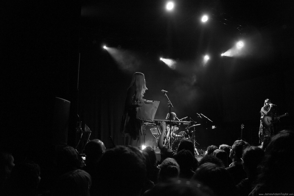 Klara Söderberg accepting a gift from a fan durring the First Aid Kit live performance at Union Transfer in Philadelphia.