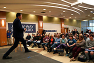 Democratic 2020 U.S. presidential candidate and entrepreneur Andrew Yang stretches while listening to a quetion at a town hall meeting  in Sioux City, Iowa, January 27, 2020.     REUTERS/Rick Wilking