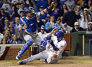 CHICAGO, IL - OCTOBER 15:  Javier Baez #9 of the Chicago Cubs steals home in the second inning, sliding under the tag of Carlos Ruiz #51 of the Los Angeles Dodgers during Game 1 of NLCS at Wrigley Field on Saturday, October 15, 2016 in Chicago, Illinois. (Photo by Ron Vesely/MLB Photos via Getty Images) *** Local Caption *** Javier Baez; Carlos Ruiz