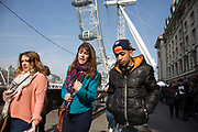 Tourists near to the London, Eye, one of the biggest draws for tourism down on the Southbank. The South Bank is a significant arts and entertainment district, and home to an endless list of activities for Londoners, visitors and tourists alike.