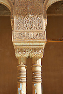 """Moorish arabesque capitals & pillars of the Palacios Nazaries,  Alhambra. Granada, Andalusia, Spain. . The Alhambra is a palace and fortress complex located in Granada, Andalusia, Spain. It was originally constructed as a small fortress in 889 CE on the remains of ancient Roman fortifications. The Alhambra was renovated and rebuilt in the mid-13th century by the Arab Nasrid emir Mohammed ben Al-Ahmar of the Emirate of Granada, who built its current Alhambra palace and walls. The Alhambra was converted into a royal palace in 1333 by Yusuf I, Sultan of Granada. The decoration of The Alhambra consists for the upper part of the walls, as a rule, of Arabic inscriptions—mostly poems by Ibn Zamrak and others praising the palace—that are manipulated into geometrical patterns with vegetal background set onto an arabesque setting (""""Ataurique""""). Much of this ornament is carved stucco (plaster) rather than stone. Tile mosaics (""""alicatado"""") of The Alhambra, with complicated mathematical patterns (""""tracería"""", most precisely """"lacería""""), are largely used as panelling for the lower part. .<br /> <br /> Visit our SPAIN HISTORIC PLACXES PHOTO COLLECTIONS for more photos to download or buy as wall art prints https://funkystock.photoshelter.com/gallery-collection/Pictures-Images-of-Spain-Spanish-Historical-Archaeology-Sites-Museum-Antiquities/C0000EUVhLC3Nbgw <br /> .<br /> Visit our ISLAMIC HISTORICAL PLACES PHOTO COLLECTIONS for more photos to download or buy as wall art prints https://funkystock.photoshelter.com/gallery-collection/Islam-Islamic-Historic-Places-Architecture-Pictures-Images-of/C0000n7SGOHt9XWI"""