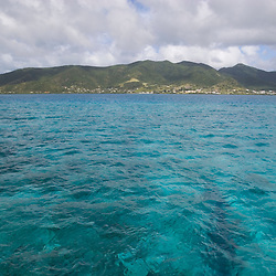 The blue waters of the Caribbean Sea over a coral reef near the island of Antigua.