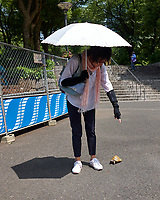 Woman walking her turtle to Niagara Falls at Shinjuku Chuo Park in Tokyo Image taken with a Leica CL camera and 18 mm f/2.8 lens (ISO 100, 18 mm, f/4, 1/400 sec).