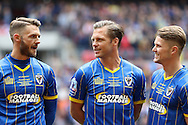 Callum Kennedy defender for AFC Wimbledon (3) and Dannie Bulman midfielder of AFC Wimbledon (4) and Jake Reeves midfielder for AFC Wimbledon (8) before the Sky Bet League 2 play off final match between AFC Wimbledon and Plymouth Argyle at Wembley Stadium, London, England on 30 May 2016. Photo by Stuart Butcher.