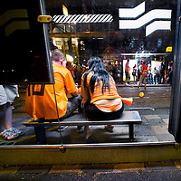 The Netherlands, Amsterdam, 11-07-2010.<br /> Fans of the Netherlands are very disappointed after the loss of the dutch football team in the final of the World Cup Football. The fans are sitting in a tram stop square nearby the Museumplein where they saw the World Cup Football in South Africa between the Netherlands versus Spain  .<br /> Photo : Klaas Jan van der Weij