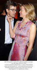 MR TIM & LADY HELEN TAYLOR at a party in London on 28th May 2002.PAL 226