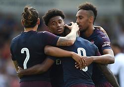 Arsenal's Reiss Nelson celebrates scoring their fourth goal during the pre-season match at Meadow Park, Boreham Wood.