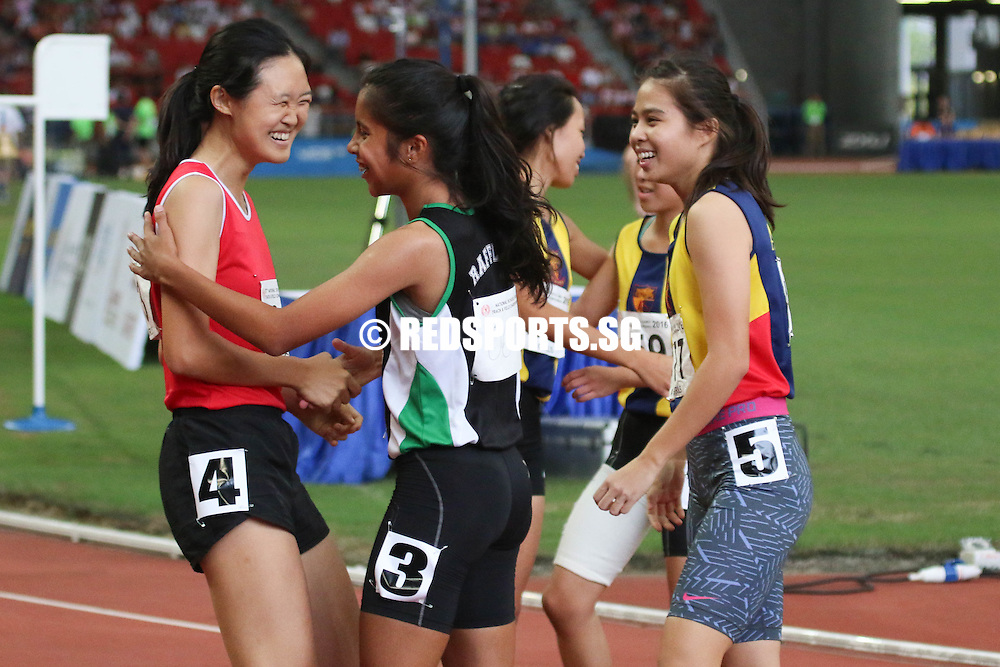 Teo Sze-Anne (left) and Amirah Aljunied (centre) sharing a moment after the A-Girls 100m sprint. (Photo © Chua Kai Yun/Red Sports) National Stadium, Friday, April 29, 2016 — Amirah Aljunied of Raffles Institution (RI) clinched the A Division Girls' 100 metres gold at the 57th National Schools Track and Field Championships, running a personal best 12.87 seconds in the final.