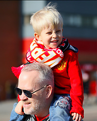 A young Manchester United fan arrives ahead of the match