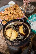 Food being fried on the street in Hanoi, Vietnam.