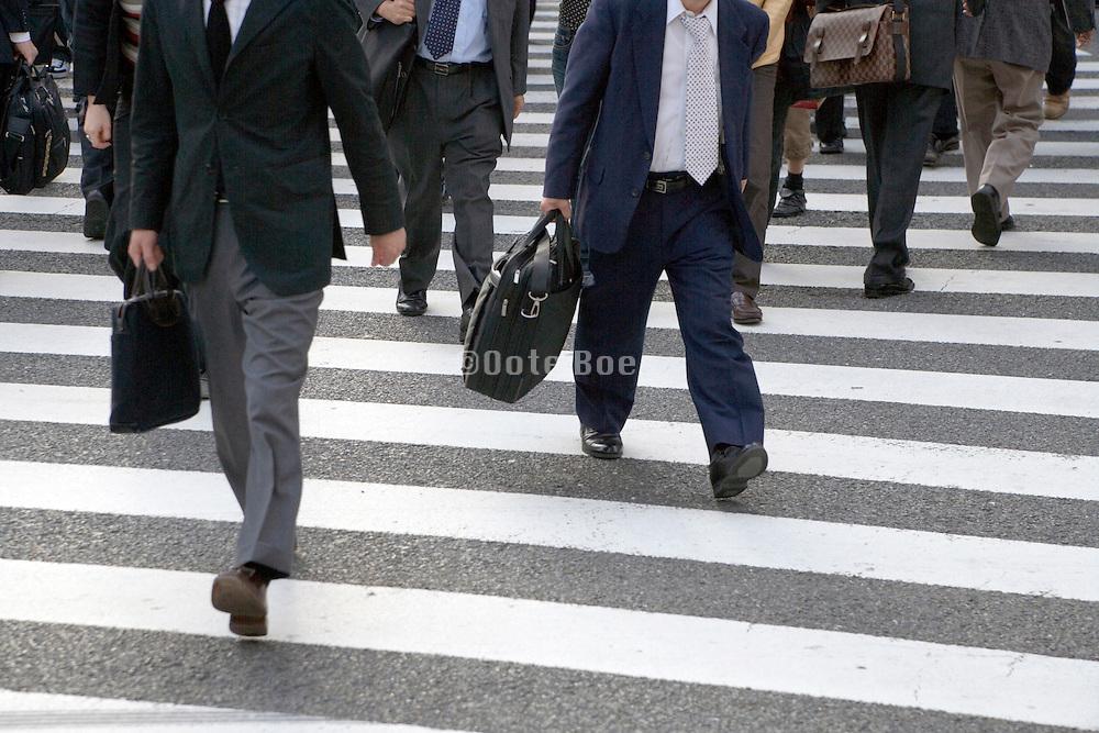 businessmen crossing a zebra
