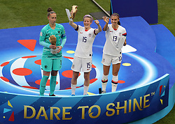USA's Megan Rapinoe receives the The Golden Ball (centre) Netherlands goalkeeper Sari van Veenendaal with The Golden Glove (left) and USA's Alex Morgan with The Silver Boot after the FIFA Women's World Cup 2019