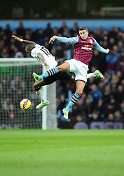 Aston Villa's Matthew Lowton battles for the high ball with Manchester United's Ashley Young  - Photo mandatory by-line: Joe Meredith/JMP - Mobile: 07966 386802 - 20/12/2014 - SPORT - football - Birmingham - Villa Park - Aston Villa v Manchester United - Barclays Premier League