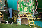 A traditional horse-pulled, barrel-top gypsy wagon belonging to Mala Blenkinsop. Mala spends a week every year with his son Liam and their sheepdog at the Appleby Fair. The milk churn is hand painted by a friend and depicts their annual week-long trip from near Newcastle.