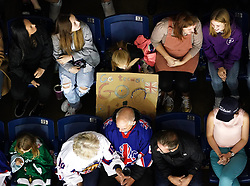 A fan in the stands with a sign supporting Great Britain during the Beijing 2022 Olympics Women's Pre-Qualification Round Two Group F match at the Motorpoint Arena, Nottingham.