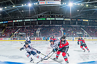 KELOWNA, CANADA - OCTOBER 27: Dylan Coghlan #10 and Sasha Mutala #34 of the Tri-City Americans stick check Gordie Ballhorn #4 of the Kelowna Rockets as he makes a pass over centre ice on October 27, 2017 at Prospera Place in Kelowna, British Columbia, Canada.  (Photo by Marissa Baecker/Shoot the Breeze)  *** Local Caption ***