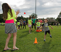 Keegan Connelly gives a good toss to Jerikah Syovia during the Balloon Toss game at the Opechee Peanut Festival Thursday evening.  (Karen Bobotas/for the Laconia Daily Sun)