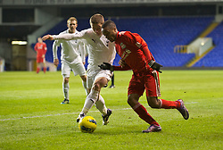LONDON, ENGLAND - Wednesday, February 1, 2012: Liverpool's Raheem Sterling in action against Tottenham Hotspur's Jack Munns during the NextGen Series Quarter-Final match at White Hart Lane. (Pic by David Rawcliffe/Propaganda)