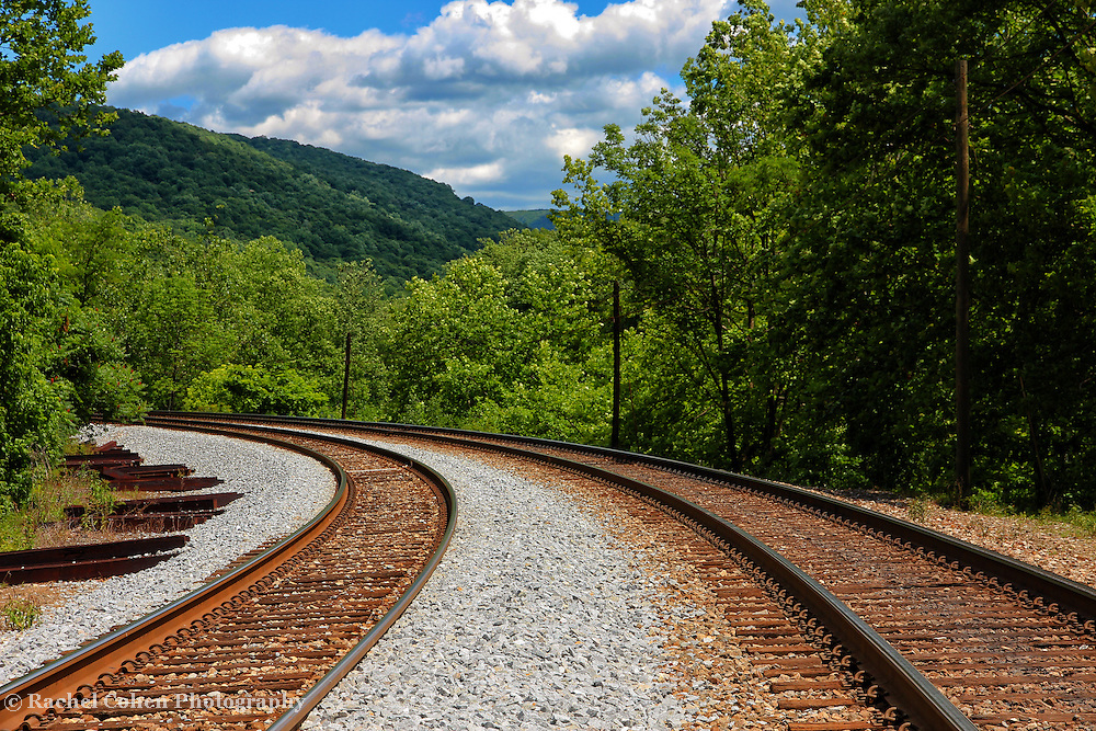 """""""Double Blind""""<br /> <br /> If you love railroad tracks, then this double set is sure to please. Going straight through Ohiopyle and winding it's way through the lush green valley with mountains and amazing skies above!!<br /> <br /> Laurel Highlands Area of Pennsylvania by Rachel Cohen"""