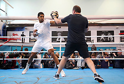 Anthony Joshua and Coach Robert McCracken during a media workout at The English Institute of Sport, Sheffield