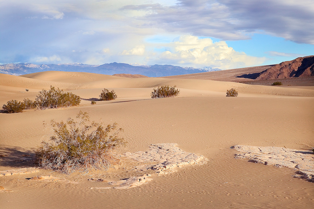 breaking thunderstorm over Death Valley dunes, Death Valley National Monument, CA