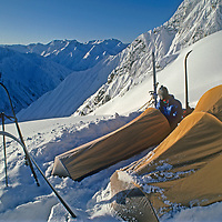 Camped atop a 16,000+ foot pass, ski mountaineer Allan Pietrasanta looks back at some of the gorges his team followed during an expedition across India's Great Himalaya Range from Ladakh to Kashmir.  Just hours later, on the other side of the pass, the team was caught in an avalanche and the photographer crushed two vertebrae, but the group finished their journey under their own power.