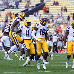 Sep 26, 2020; Baton Rouge, Louisiana, USA; LSU Tigers linebacker Damone Clark (18) celebrates with teammates aagainst the Mississippi State Bulldogs during the first half at Tiger Stadium. Mandatory Credit: Derick E. Hingle-USA TODAY Sports