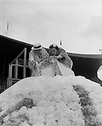 Y-540612-017. Queen Jan I being positioned on the top of her float. Rose Festival, Grand Floral Parade. June 12, 1954.