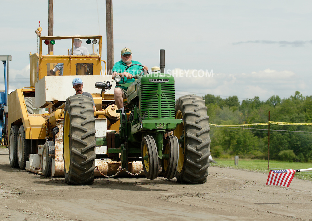 Otisville, NY - The front wheels of a Farmall tractor lift off the ground during the tractor pulling competition at the Otisville Country Fair on Aug. 26, 2007.