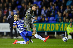 Jamie Vardy (ENG) of Leicester City is challenged by Daniel Williams (USA) of Reading - Photo mandatory by-line: Rogan Thomson/JMP - 07966 386802 - 14/04/2014 - SPORT - FOOTBALL - Madejski Stadium, Reading - Reading v Leicester City - Sky Bet Football League Championship.