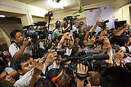 For few minutes the horde of journalists are allowed into the NLD office where a meeting of the elected MPs is going on. Yangon, Myanmar. 2012