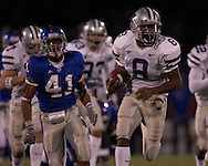 Kansas State's James Johnson (8) takes a fourth quarter kickoff back 85-yards for a touchdown against Kansas at Memorial Stadium in Lawrence, Kansas, November 18, 2006.  Kansas beat K-State 39-20.<br />