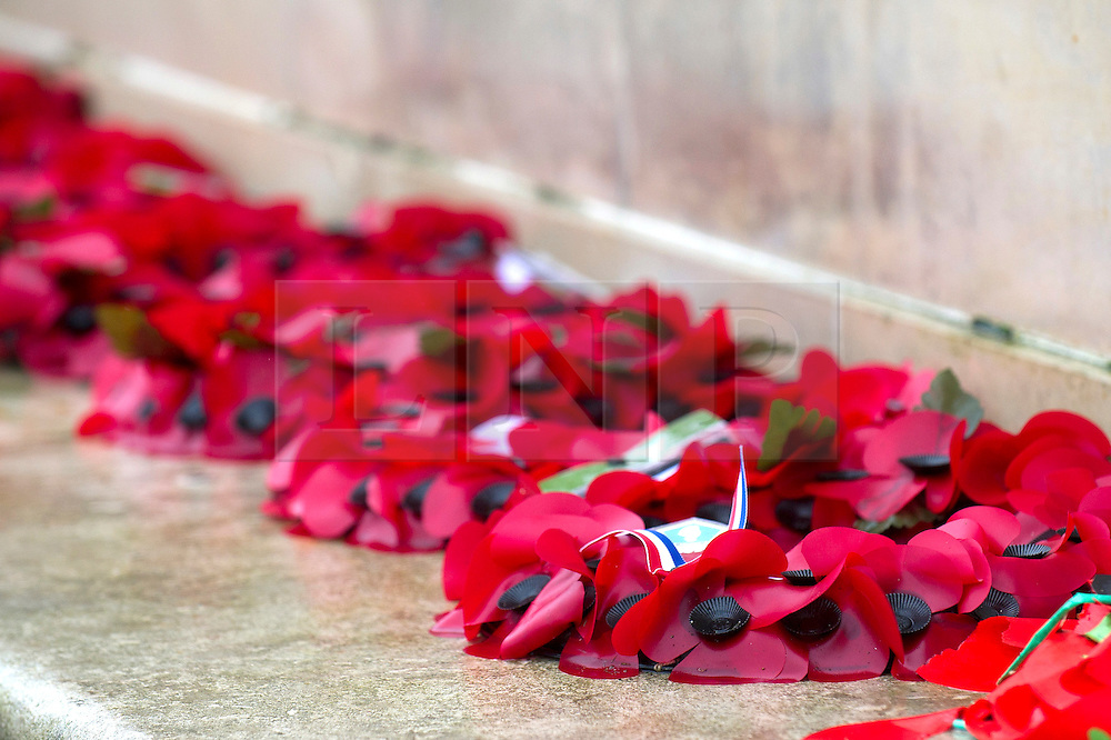 © under license to London News Pictures.  11/11/2010. Poppies lie in the rain at Plymouth.  People around the UK have observed a two-minute silence to mark Armistice day. Poppies after heavy rainfall in Plymouth.