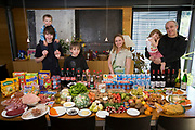 Luxembourg. Family portrait of the Engel family with one week's worth of food in April. The Hungry Planet project.