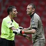 Referee's Ozgur YANKAYA (L) and Galatasaray's goalkeeper Ufuk CEYLAN (R) during their Turkish Super League soccer match Galatasaray between Konyaspor at the T T Arena at Seyrantepe in Istanbul Turkey on Sunday, 20 May 2011. Photo by TURKPIX