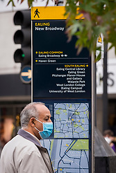 © Licensed to London News Pictures. 17/10/2020. LONDON, UK. A man wearing a facemask is seen next to a local directions map in Ealing, west London.  The Office for National Statistics (ONS) has reported that the confirmed coronavirus cases in the capital exceed 67,000, with Ealing having the highest Covid-19 rate amongst London Boroughs at 144 cases per 100.  Following the UK Government's announcement, the capital has today moved from Tier 1 to Tier 2, meaning a ban on indoor social mixing between households in the capital.  Photo credit: Stephen Chung/LNP