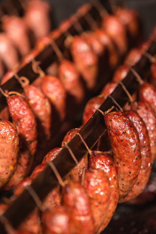 Sausages smoking in a smoker in Texas