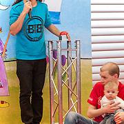 NLD/Amsterdam/20130220 - Ieder jaar vind je op de Negenmaandenbeurs wel bekende Nederlanders. De Negenmaandenbeurs 2013 wordt geopend door niemand minder dan Ali B. De rapper is ongetwijfeld één van de hipste jonge vaders van Nederland, dus wat wil je nog meer?? Hoe maak je een baby aan het lachen? Ali B laat het zien tijdens de spetterende opening van de Negenmaandenbeurs op 20 februari. Hij leert kersverse vaders de kneepjes van het vak!