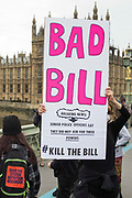An activist holds a sign on Westminster Bridge during a Kill The Bill protest against the Police, Crime, Sentencing and Courts PCSC Bill 2021 as MPs consider amendments to the Bill in the House of Commons on 5th July 2021 in London, United Kingdom. The PCSC Bill would grant the police a range of new discretionary powers to shut down protests, including the ability to impose conditions on any protest deemed to be disruptive to the local community, wider stop and search powers and sentences of up to 10 years in prison for damaging memorials.